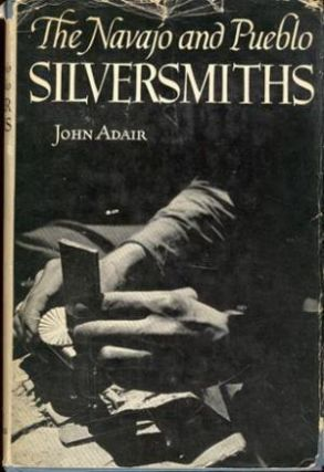 THE NAVAJO AND PUEBLO SILVERSMITHS. J. Adair